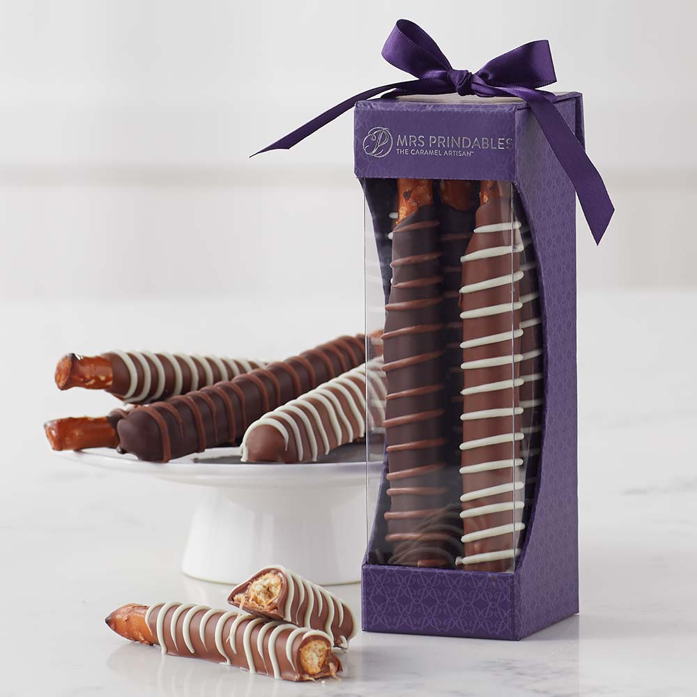 Four assorted Chocolate and Caramel Dipped Pretzels in a Mrs Prindables gift box